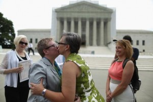 "WASHINGTON, DC - JULY 24: Libby Enloe (2nd L) and Amanda Adams, both of Winston-Salem, North Carolina, embrace and kiss after being married outside the U.S. Supreme Court building on Capitol Hill July 24, 2013 in Washington, DC. Enloe's mother, Mary Ann Enloe (L) and Adams' sister, Meredith Boggs (R), were witnesses to the ceremony. A couple for more than 21 years, Enloe and Adams decided to get married outside the court after the justices struck down the Defense of Marriage Act last month. The location is symbolic, Enloe said. ""This makes it official which is what we were waiting for,"" she said. (Photo by Chip Somodevilla/Getty Images)"